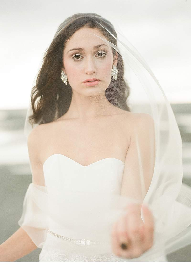 Sara Donaldson Photograph | Charleston, SC | Folly Beach, Edge of America | Edge of the Storm Bridal Portraits | Gown: Saint Isabel | Veils and Belt: Melinda Rose Design | Hair: Lauren Campion, Studio M | Makeup: Jonny Cosmetics | Earrings: Vintage | Floral: Stephanie Gibbs | Model: Lauren Dwyer, Directions USA